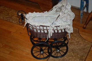 Victorian Style Brown Wicker Doll Buggy/ Carriage. photo