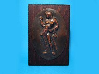 Decorative Copper Plaque On Wooden Plate,  Hercules photo