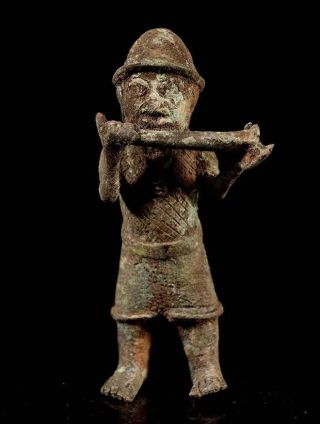 Nigeria: Old Tribal Bronze Benin Figure. photo