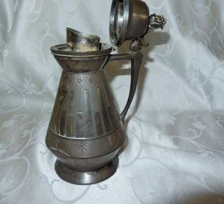 Antique Meridian Company Silver Plated Syrup Pitcher photo