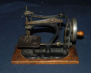Rare Antique Heavy Cast Iron German Handcrank Sewing Machine W/wooden Base photo