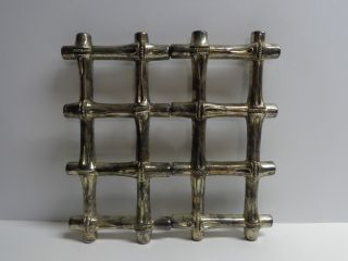 Silver Colored Metal Expandable Trivet Bamboo Look photo