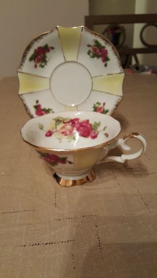China Footed Tea Cup And Saucer - Floral Pattern photo