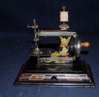 Rare Antique German Casige Angel Fairy & Archer 121 Hand Crank Sewing Machine photo