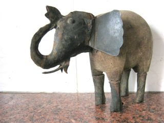 Antique Elephant Door Stop.  Iron And Wood. photo