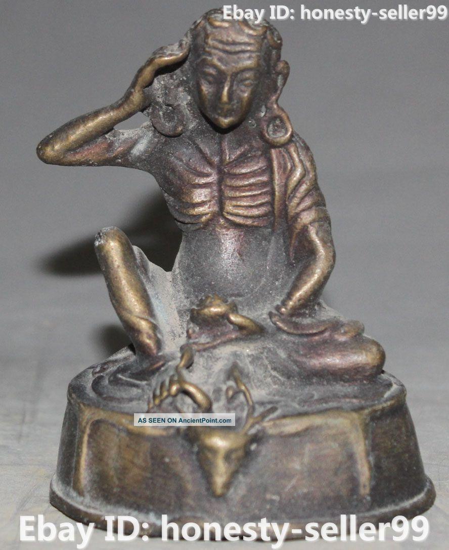 Tibet Buddhism Bronze Carving Milarepa Dig Ear Buddha Deer Head Statue Buddha photo