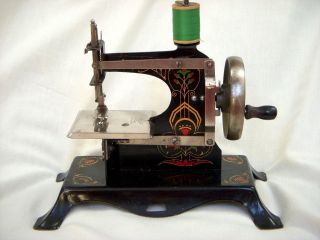 Antique Germany Casige Eagle Tin/tole Painted Toy Mini Sewing Machine Hand Crank photo
