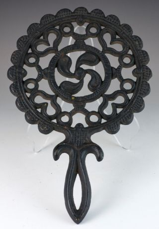 Vintage Cast Iron Tulip Trivet 3 Legs 70h photo