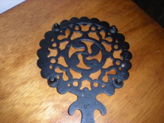 Vintage Cast Iron Tulip Trivet photo