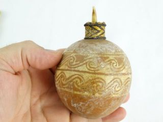 Vintage Papuan Incised Lime Gourd With Orchid Stem Stopper Png Papua Guinea photo