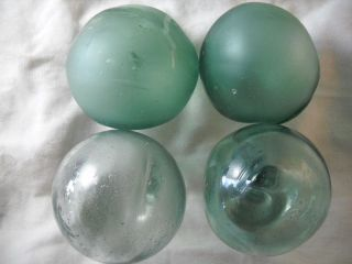 4 Vintage Japanese Odd Shaped And Dented Glass Floats Alaska Beach Combed photo