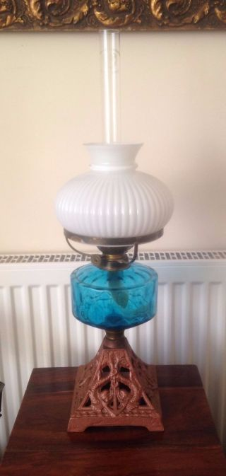 A Victorian Blue Glass Oil Lamp And Shade Order Kosmos Burner photo