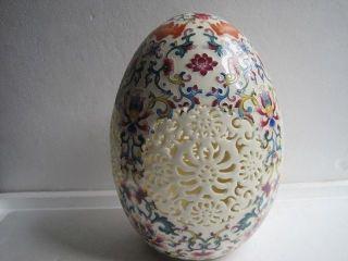 Chinese Rose Colorful Porcelain Porcelain Egg Shape Openwork Carving Vase photo