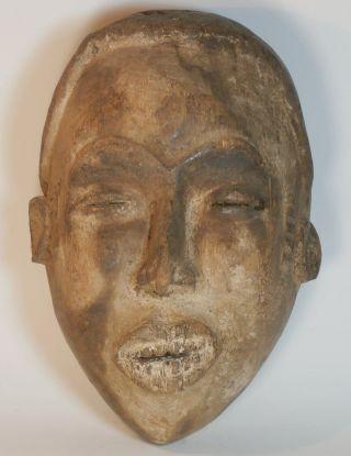 Old Igbo Maiden Spirit Mask (agbogho Mmuo) Igboland,  Nigeria photo