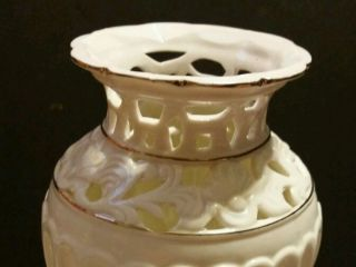 White Porcelain Vase With Gold Trim photo