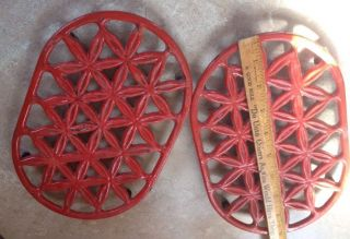 Vintage Cast Iron Red Enamel Oval Trivets W/ Feet photo
