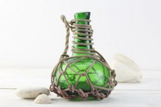 Vintage,  Green Glass,  Pirates Rum Jug In Rope Netting,  Beach Decor photo