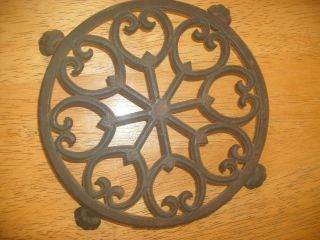 Antique / Vintage Footed Cast Iron Ornate Trivet photo
