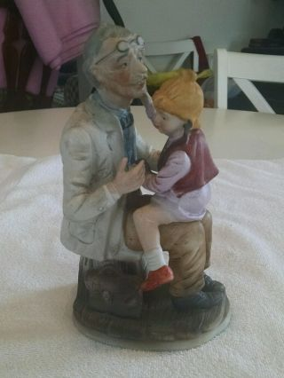 Porcelain Figurine Statue Of Girl With Doctor photo