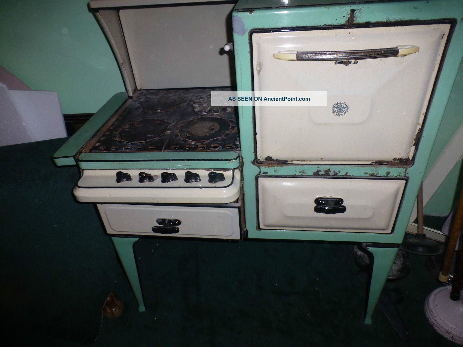 antique 1920 39 s even heet gas stove porcelain cast iron urners double oven. Black Bedroom Furniture Sets. Home Design Ideas