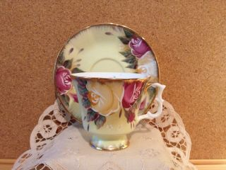Antique Cup And Saucer,  Yellowish Gold With Yellow & Red Roses photo