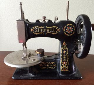 Antique Stitchwell Toy Sewing Machine - Cast Iron photo