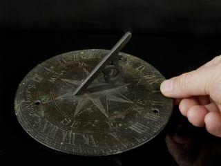 An Antique Bronze Sundial,  Motto