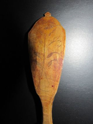 Decorative Wooden Spoon With Carved Decorations Antique Kitchen Utensil photo