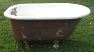 Vintage 4 Foot Cast Iron Claw Foot Tub With Claw Feet photo