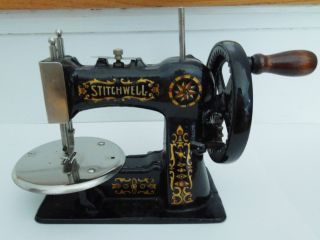 Vintage 1920s Cast Iron Antique Childs Stitchwell Sewing Machine Toy photo