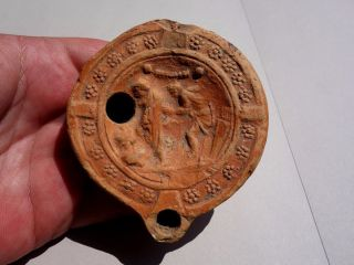 Roman Terracota Oil Lamp Decorated In Mythological Situation - Inscribed On Bottom photo