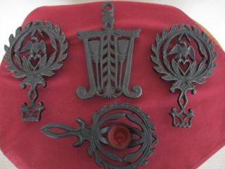 Four Vintage Cast Iron Trivets - Eagle Broom Harvest Candle Footed L@@k photo