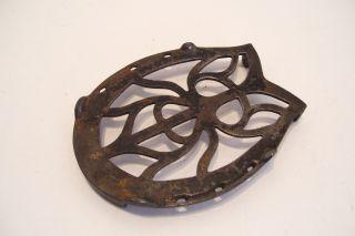 Antique Cast Iron Trivet Scarab Design Horseshoe Shape photo