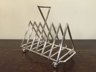 In The Style Of Christopher Dresser,  A Silver Plate Deco Toast Rack.  Offers? photo
