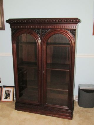 Antique Victorian Carved Bookcase With Gothic Arched Doors photo