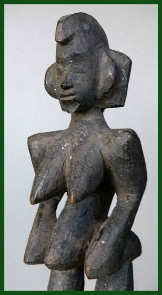 Encrusted Altar Figure From The Senufo Tribe Of Burkina Faso photo