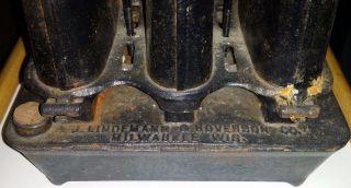 A.  J Lindemann & Hoverson Co.  Sad Iron Heater,  Three Wicks photo