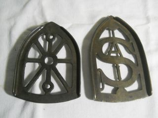 2 Antique Cast Iron Clothes Iron Trivets One Marked Sa photo