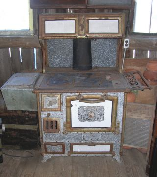 Early 1900s Antique Home Comfort Wood Coal Cook Stove photo