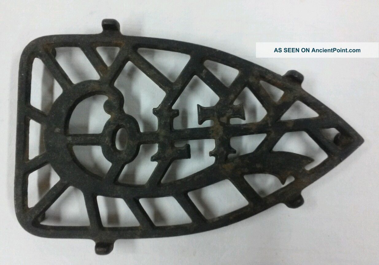 1903 Antique Colt Co.  Sad Iron Trivet Trivets photo