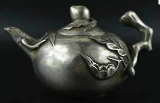 China Decorative Tibet Silver Carved Peach Shaped Teapot photo