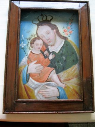 Antique Retablo On Tin With The Image Of Saint Joseph With Christ Child photo