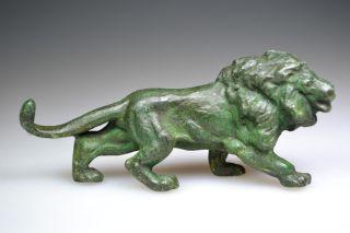 Roman Bronze Figurine Of A Lion photo