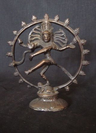 Shrine Statue Of Shiva In The Dance Of Life And Renewal With Fire Ring photo