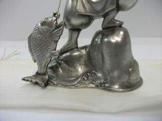 A God Of Ebisu (mythology) Of The Silver.  One Of Japanese Seven Lucky Gods. photo