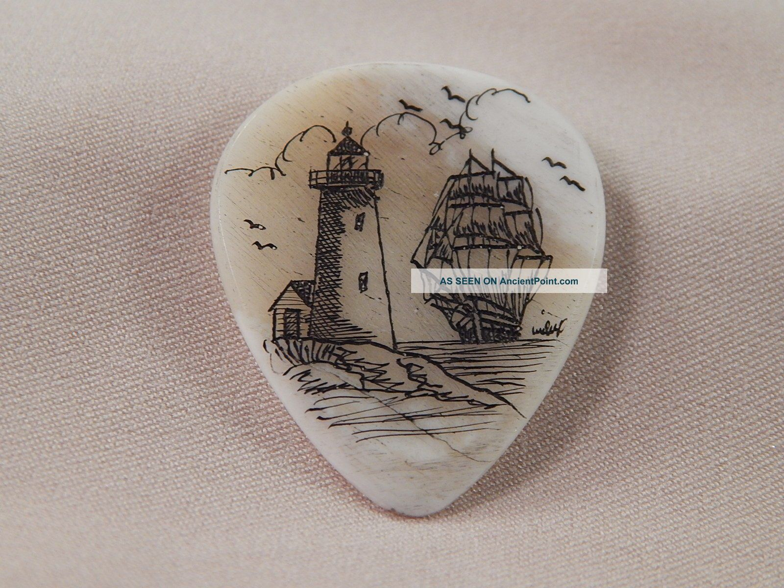 Scrimshaw Camel Bone Guitar Pick - Lighthouse - Ship Scrimshaws photo