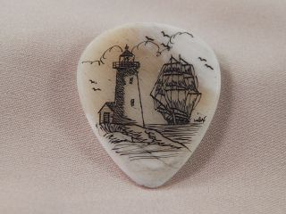 Scrimshaw Camel Bone Guitar Pick - Lighthouse - Ship photo