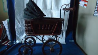 Vintage Wicker Baby Doll Buggy With Wooden Wheels photo