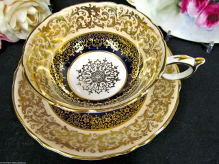 Paragon Tea Cup And Saucer Peach & Cobalt Blue Gold Gilt Pattern Teacup photo