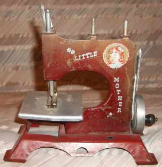 Vintage Antique Little Mother Artcraft Metal Childs Toy Sewing Machine Hand Turn photo